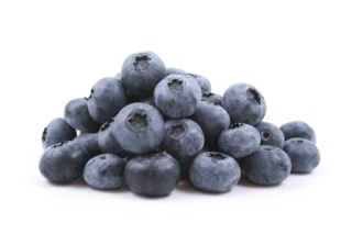 pile of fresh blueberries isolated on white